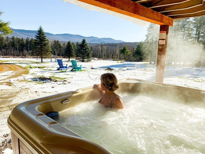 woman in an outdoor hot spa snowy landscape