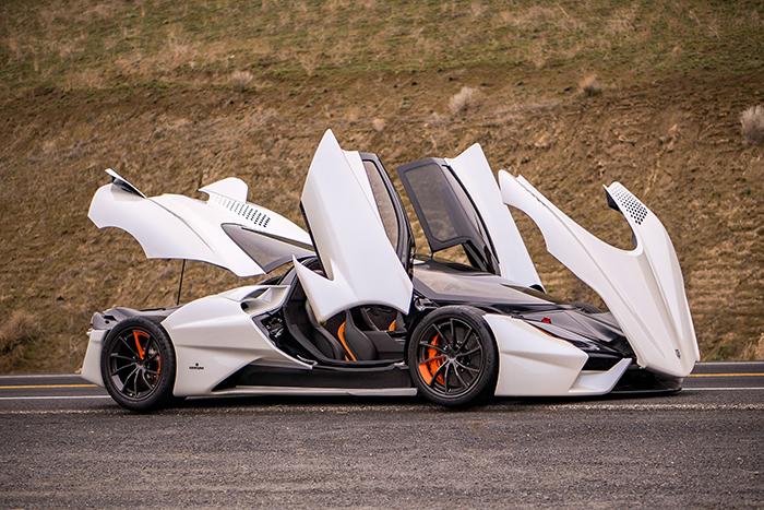 SSC Tuatara open doors outdoor white super sports car