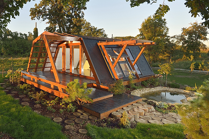 Tiny eco home idea wooden home with a garden and a lake