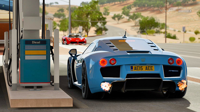 Noble M600 at the fuel station light blue sports car