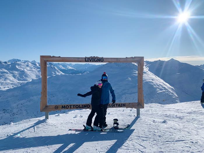 Livigno winter resort couple photo frame winter landscape