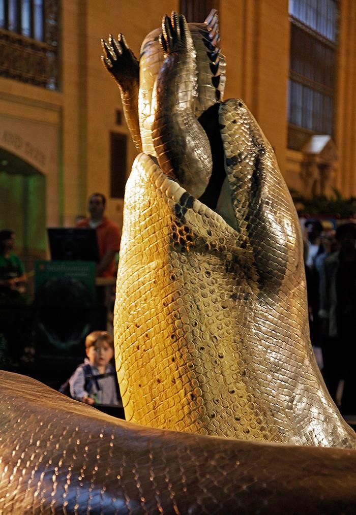 Titanoboa replica eating a crocodile museum statue
