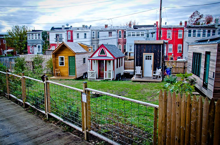 tiny house community three small colorful houses with a small garden