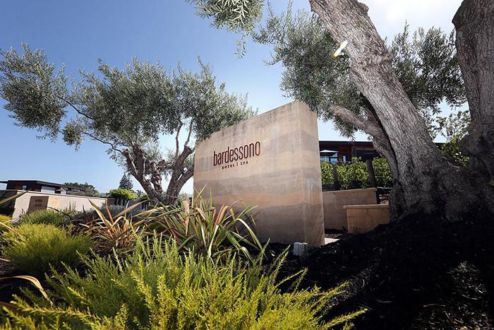 Bardessono hotel sign front garden greenery