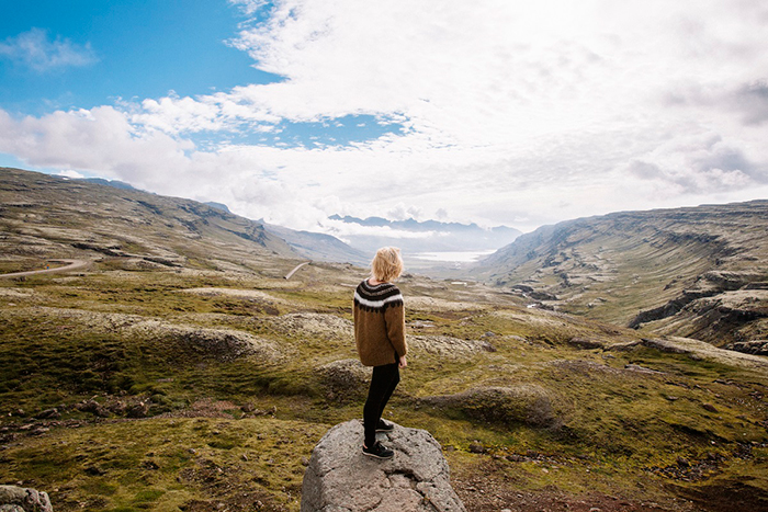 North Europe Iceland Nature woman standing on a rock beautiful view mountain