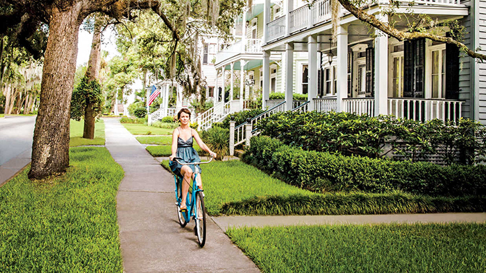 benefits in living in a small town girl riding a bicycle on a lane