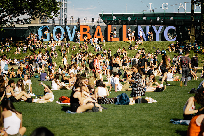 Governors Ball New York People sitting outside in the sun crowded outdoor space