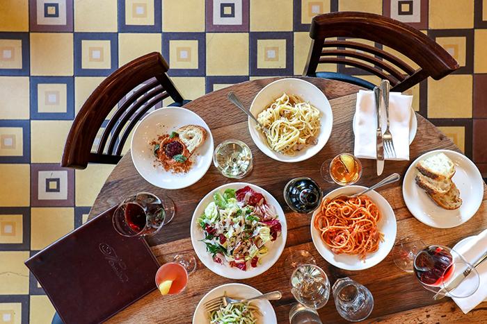 Best Italian Restaurant New York City full table dishes italian food tiled floor