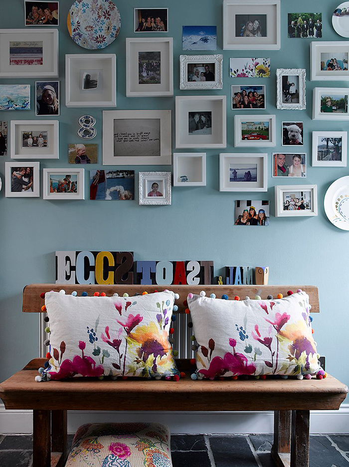 Cool photo wall idea organized chaos small pictures white frames