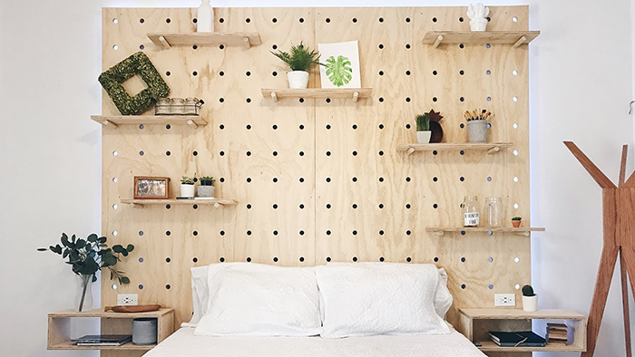 Pegboard bed headpiece idea with shelves
