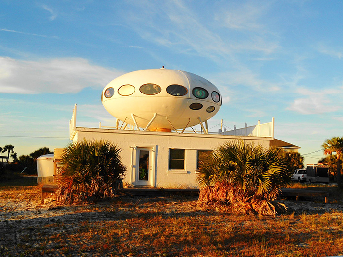 Futuro house exterior on the roof of a building white UFO-shaped home