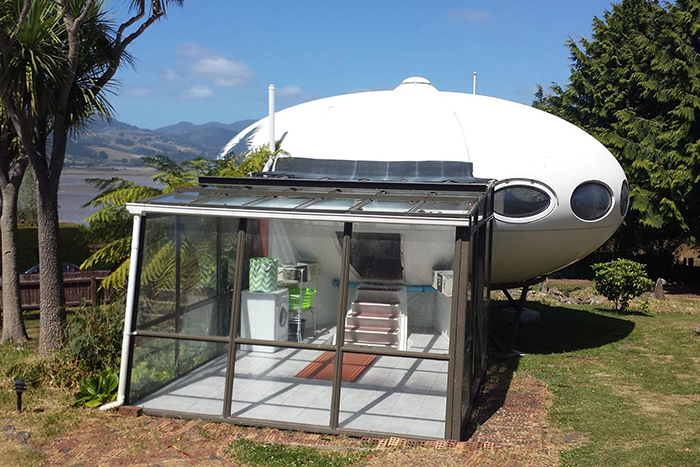 Futuro house for sale with additional module glass room