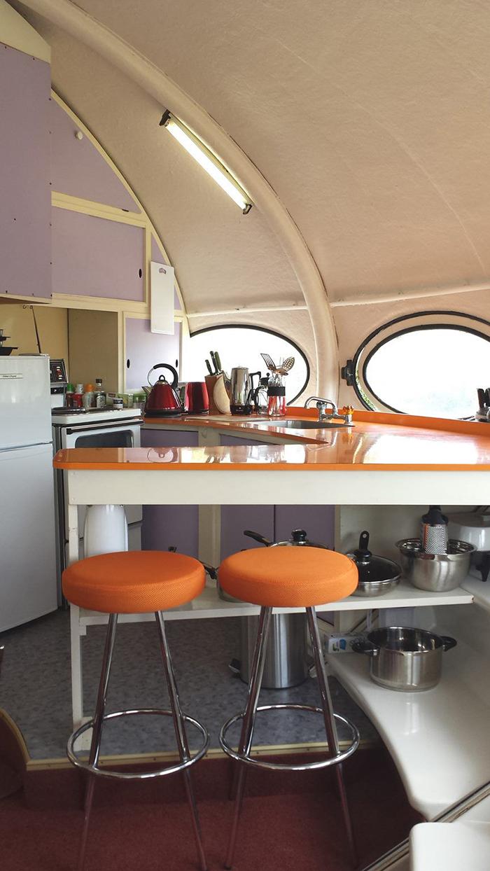 Futuro house interior ideas orange chairs round windows