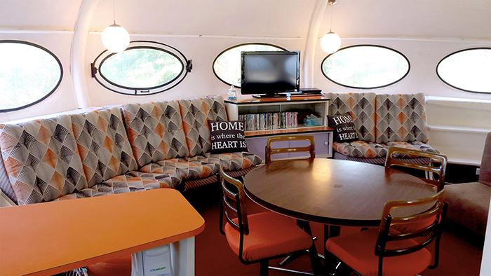 Futuro house interior sofa dining table chairs round windows