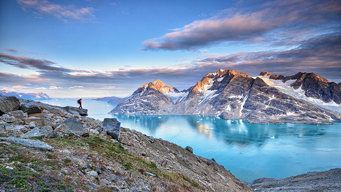 Greenland beautiful landscapes mountains light blue water hiker