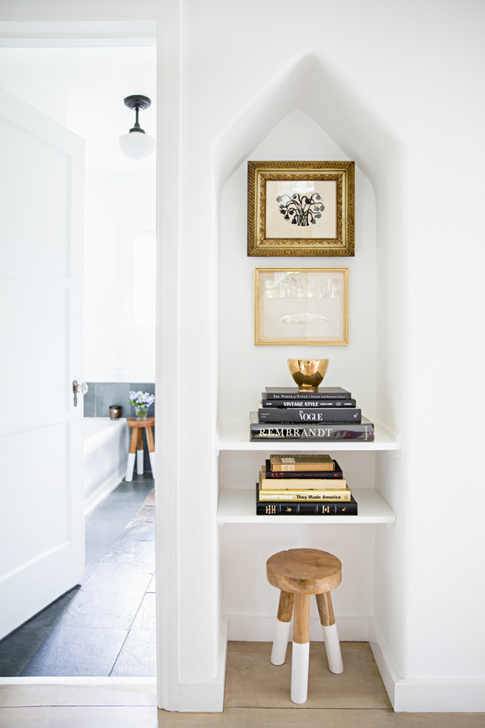 liven up unexpected spots small photo wall shelves framed pictures