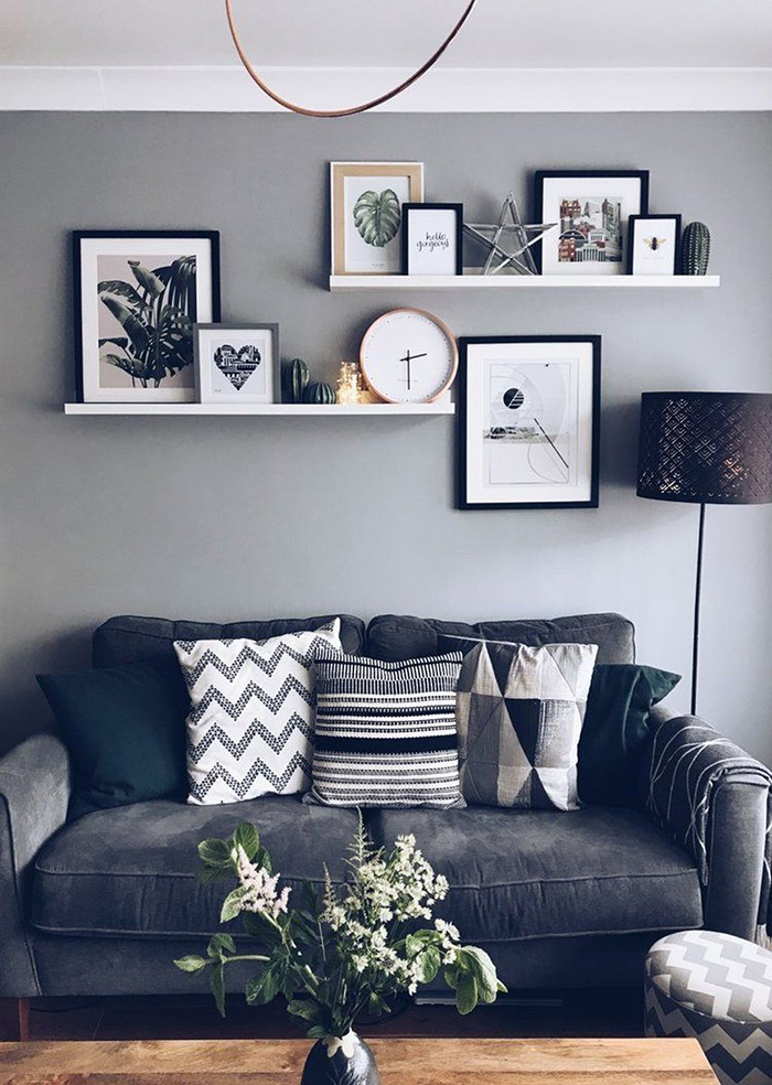Neutral look black white and grey photo wall shelves photo frames living room design trend