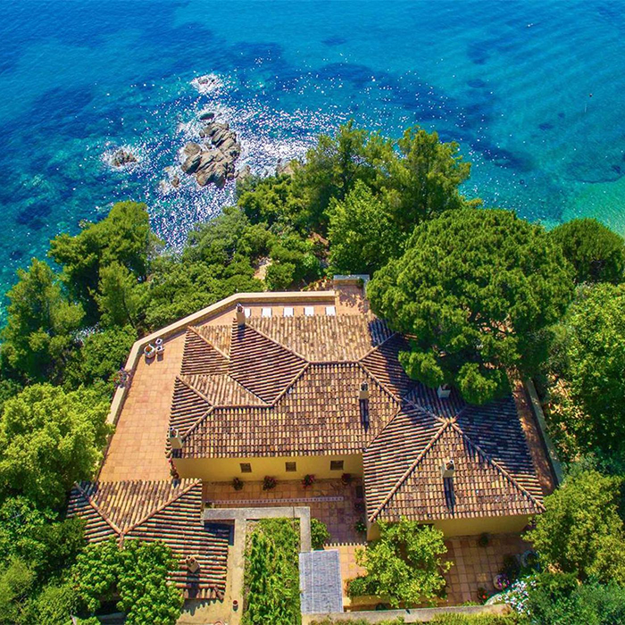 Island for sale in Greece beautiful building blue sea greenery
