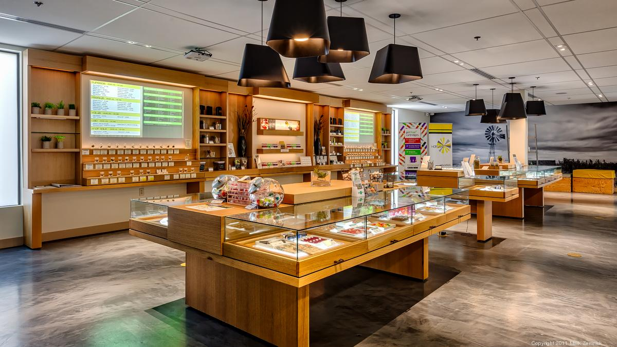 Medical Marijuana dispensary with bright lights and wooden bars
