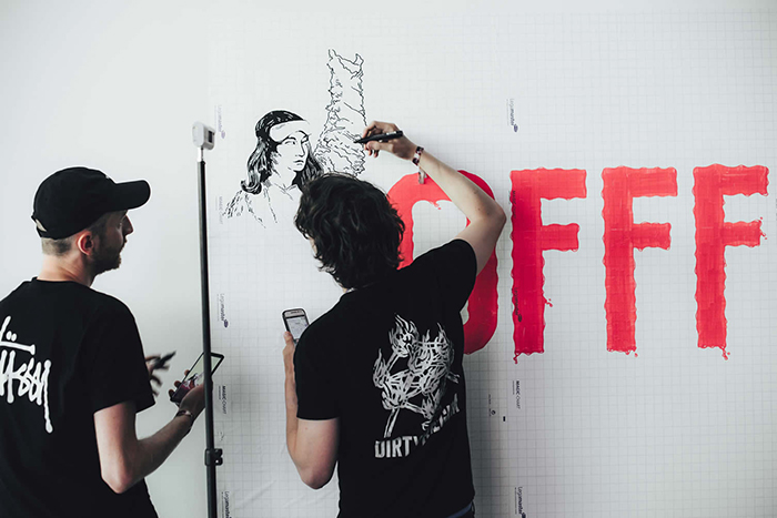 OFFF Music Art Festival Spain artists paining on a white wall