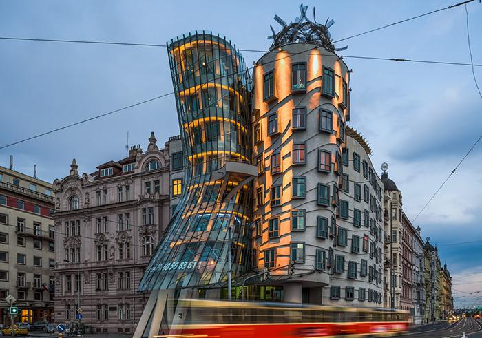 Modern Prague architecture dancing house at night tram