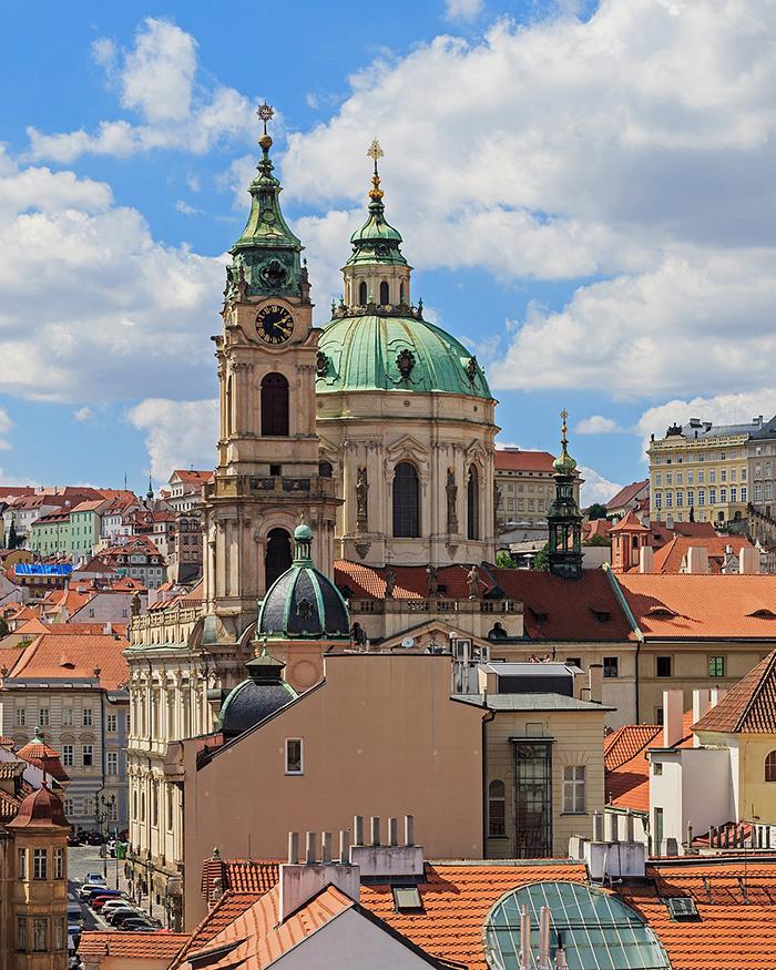 Prague architecture St. Nicholas Church towers clock tower famous Prague buildings