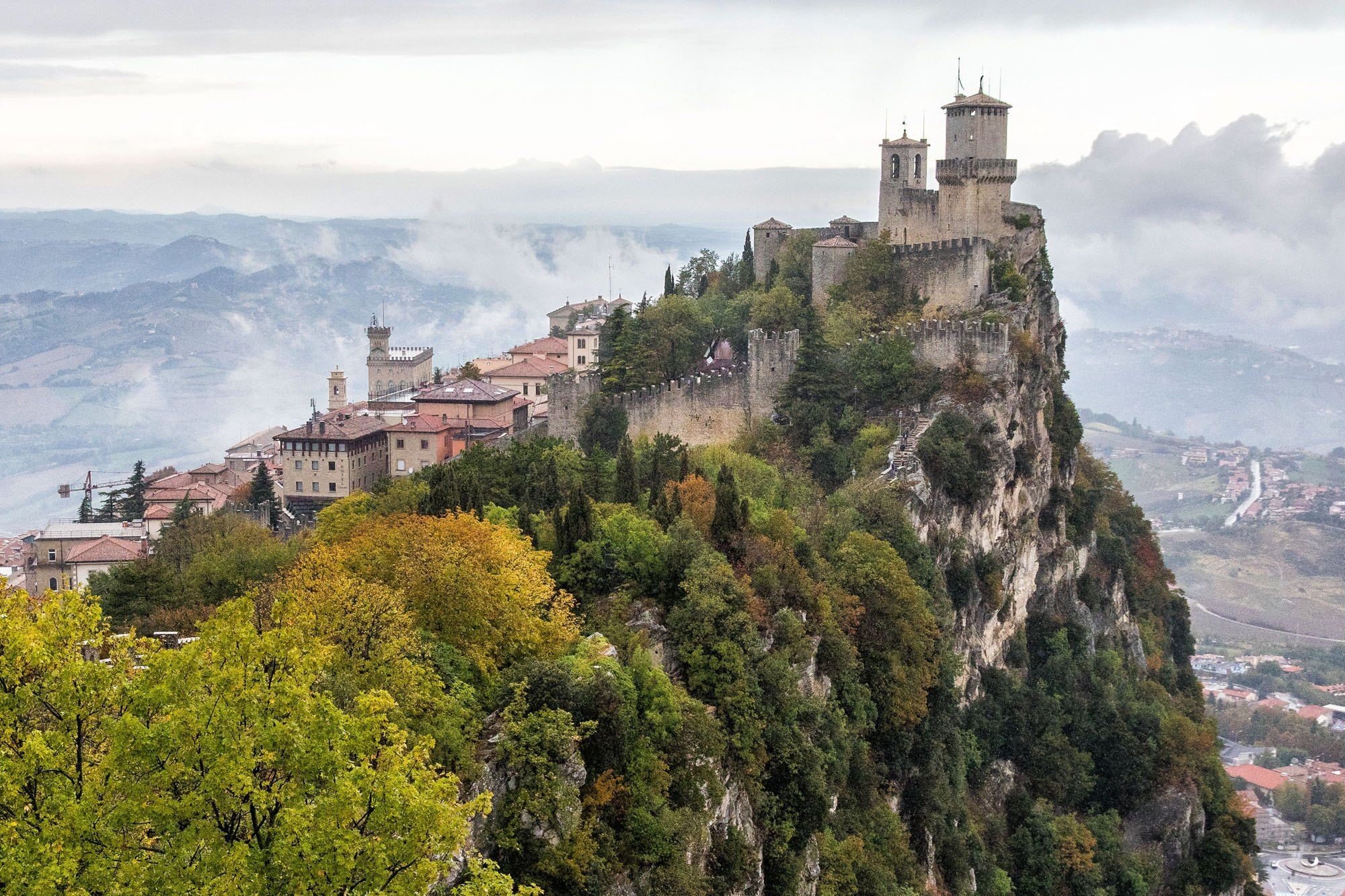 San Marino castles the view on the hill top fortress old monastery in clouds