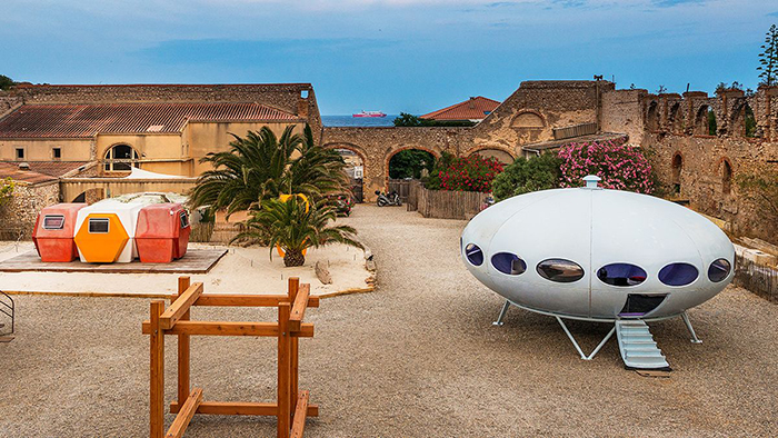Futuro house in a yard buildings palm trees