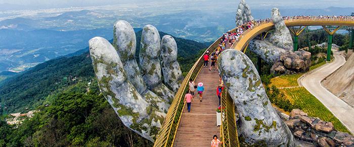 Hand bridge Vietnam close up hands tourists aerial view hills mountain top