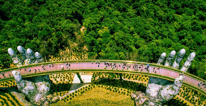 Golden Bridge Vietnam hand bridge view from above tourists on a bridge