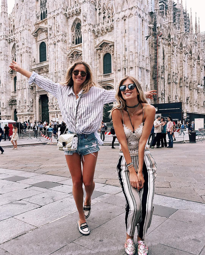 Two girlfriends in front of a cathedral Italy Milan Duomo