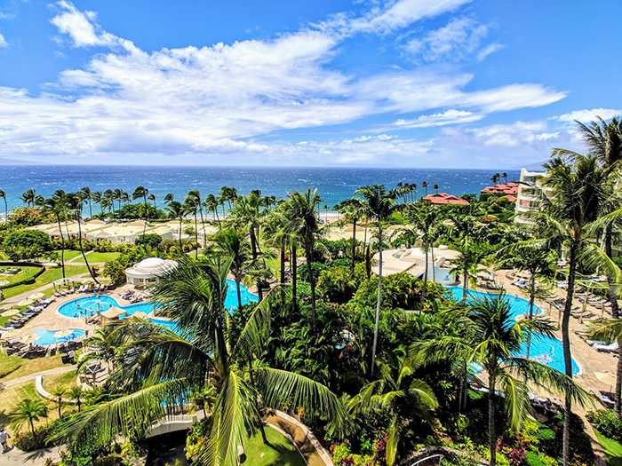 Top resorts hawaii Fairmont Kea Lani palm trees outdoor water park ocean view