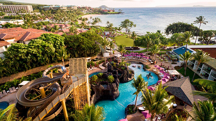 Top Hawaii Resorts view from above outdoor pool water slide palm trees white beaches