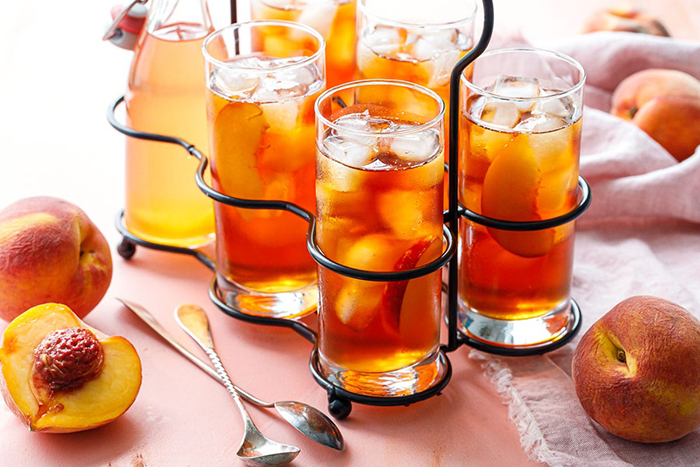 Pretty Iced Tea Refreshing Summer Drinks Peaches in tall glasses on a table