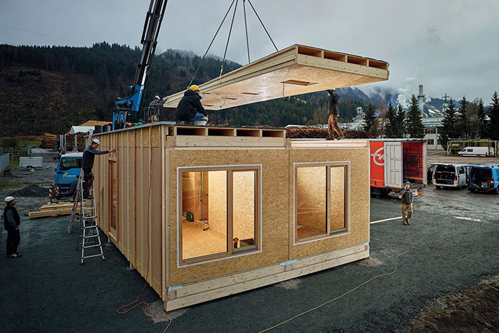 Quick Build Homes Construction Site building work people placing a roof of a prefabricated home