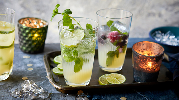 Virgin Mojito summer drink ideas two glasses on a tray full of refreshing drink fruits mint candles slices of lemon
