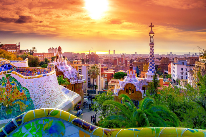 View from above Barcelona sunset colorful buildings Gaudi park