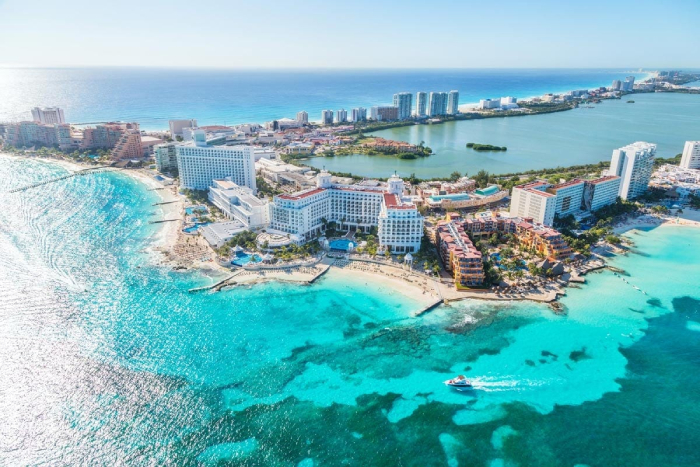 view from above cancun mexico with crystal clear water and luxury hotels