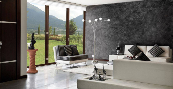 modern interior with a black stucco wall white furniture and large window lookin outside