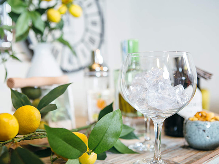 refreshing summer drinks ideas empty glass with ice on a table with lemon decor