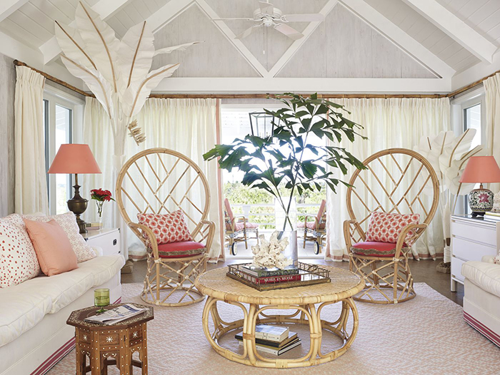 Pastel colored design summer house ideas rattan furniture chairs and a table white couch and tall green branches