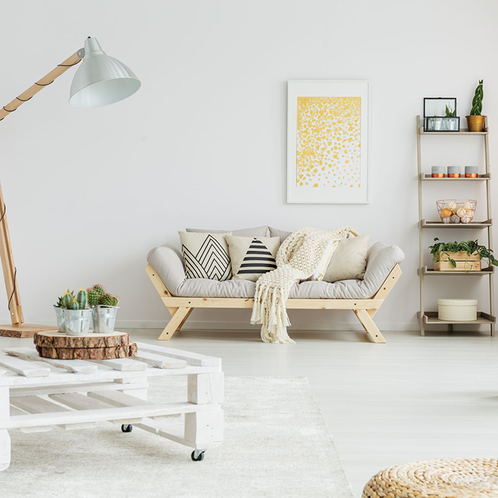 recycled furniture summer inspiration white minimal living room with a wooden couch white table and green plants