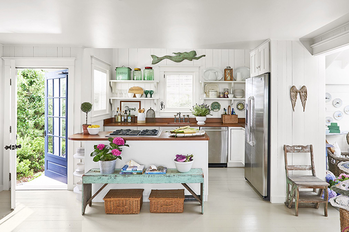 Summer house interior ideas white and blue kitchen with summery decor and open door