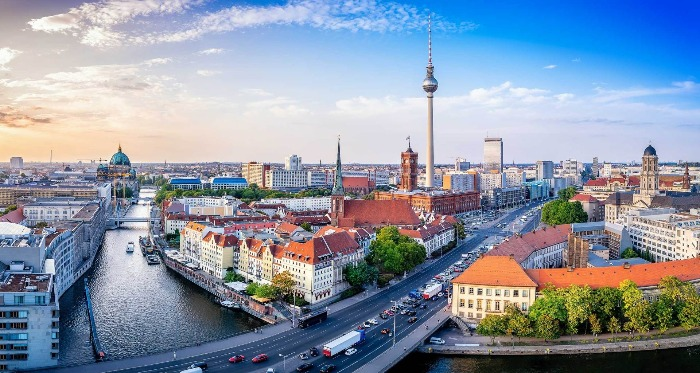 view of Berlin with a river and a tall tower