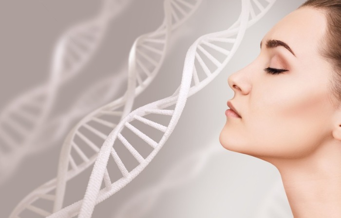woman on a gray background with DNA spirals