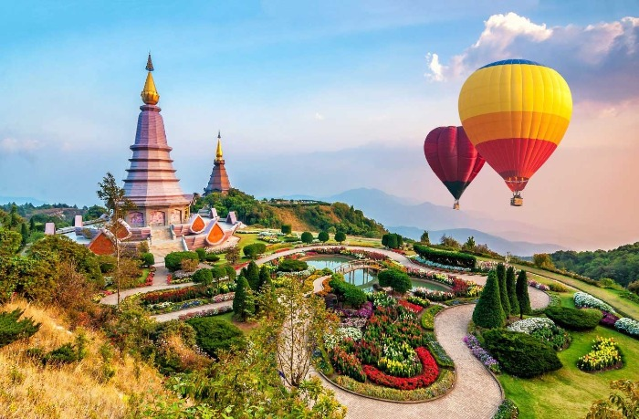 chang mai view from above with hot air balloons garden temples sunset