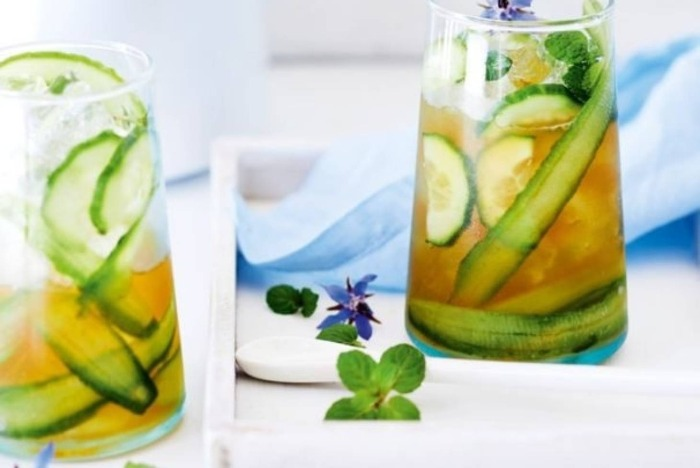cucumber tea in glasses with slices of cucumber and mint leaves