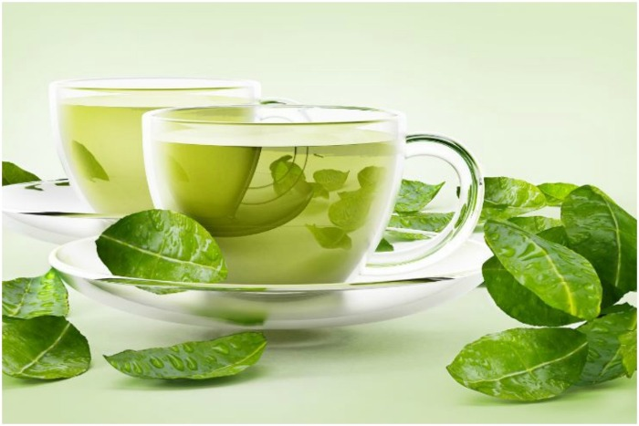 two glass cups of green tea green tea leaves