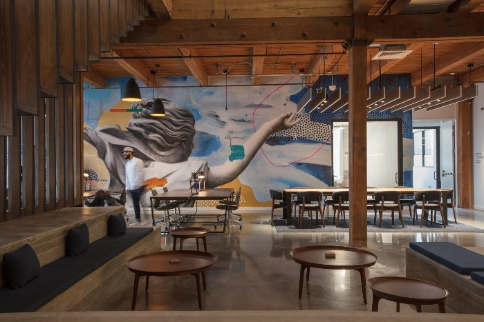 new orleans coworking space industrial design open space with wall paintings
