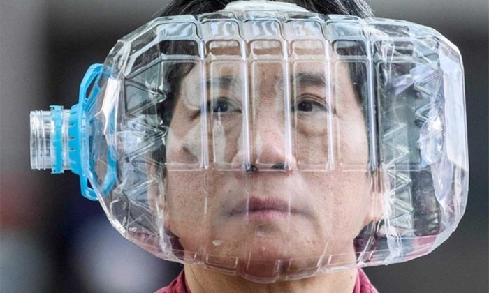 face mask from recycled materials asian person wearing a plastic water bottles transformed into a mask